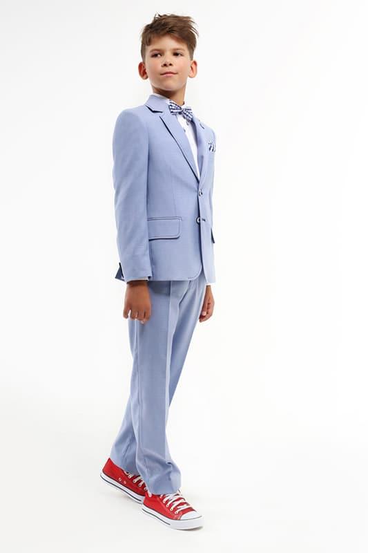 junges kind in eleganter kommunions mode vom haus der braut und gentleman 4