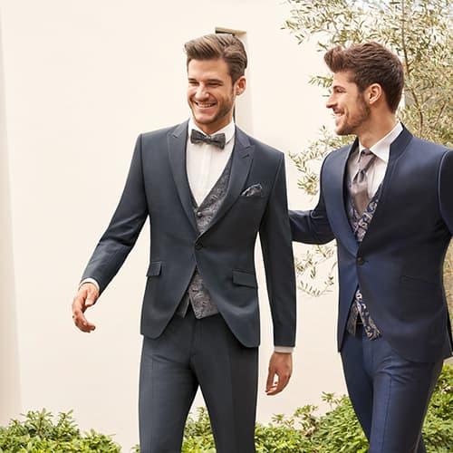 zwei junge maenner in eleganten anzuegen